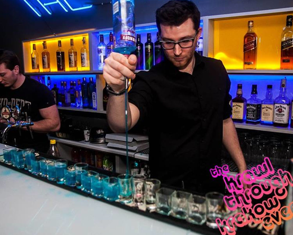 Bar man pouring vodka